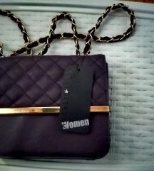 Nova modna torbica,se z etiketo