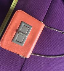 oranžna mala torbica