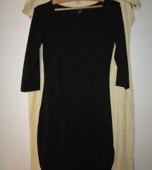 Elastična črna obleka