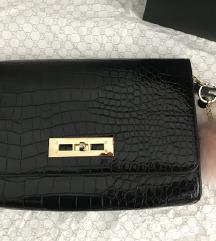 Popolnoma nova torbica